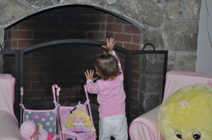 Ally decided to throw the little people dolls into the fireplace...=)